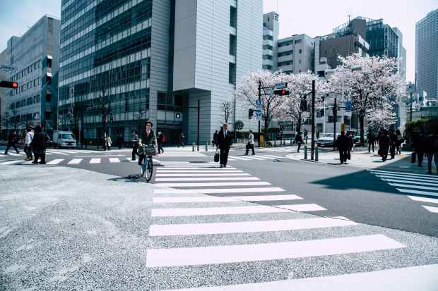 people crossing pedestrian lane