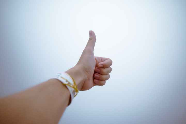 person doing thumbs up
